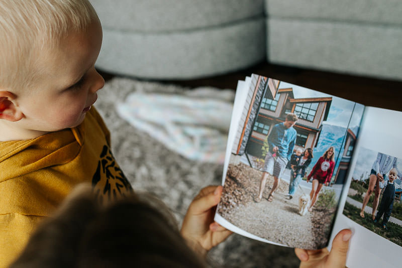Kid looking at family photography book