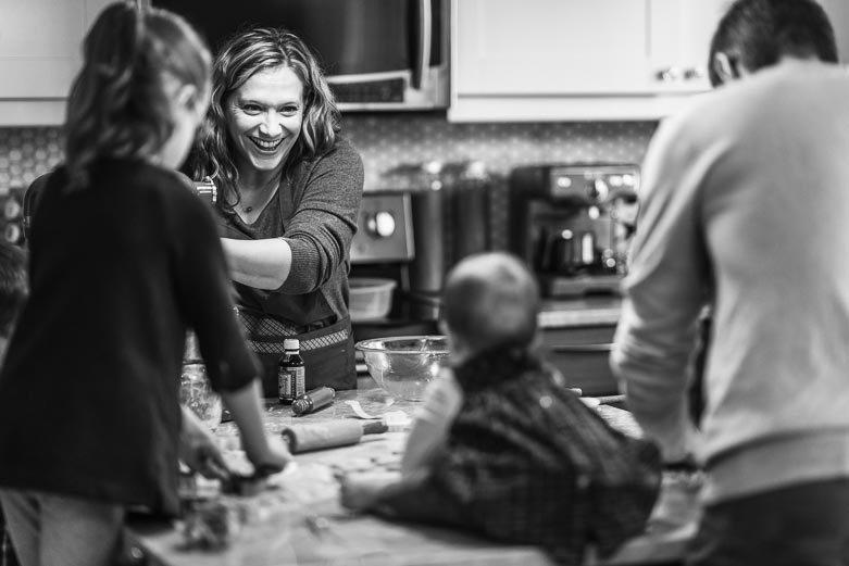 Mother smiling at baby sitting on the kitchen counter