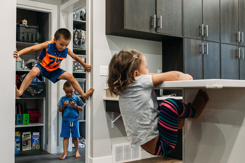 Kids climbing on walls and counters