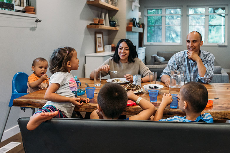 Parents encourage their kids to be themselves. Family having breakfast together.