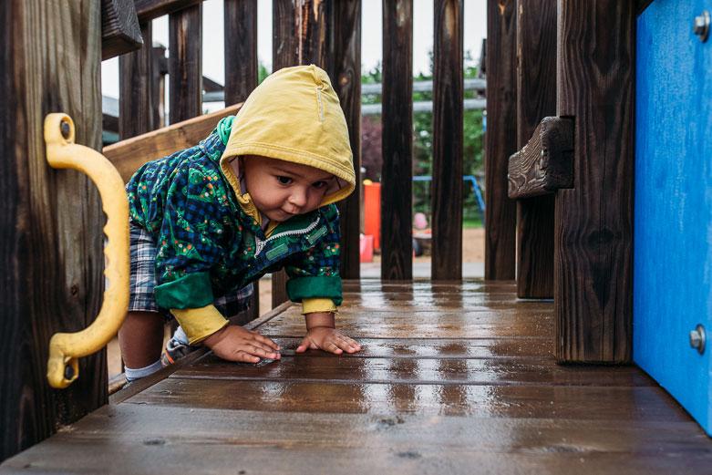 Baby boy on playground structure