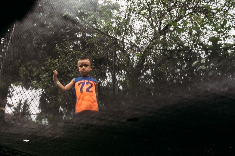 Boy seen from underneath the trampoline