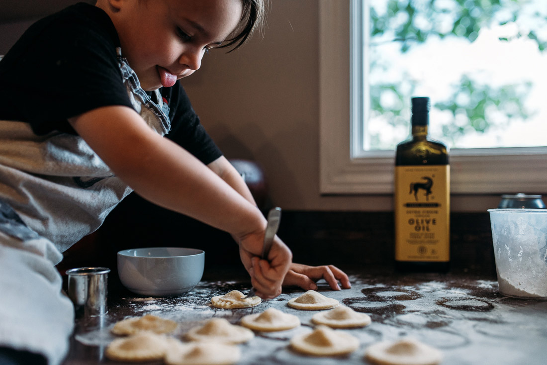 Boy making fresh ravioli