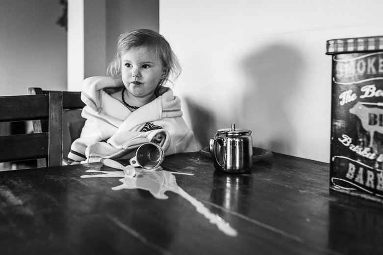 A day in the life in Alberta: toddler girl spilled milk on the table