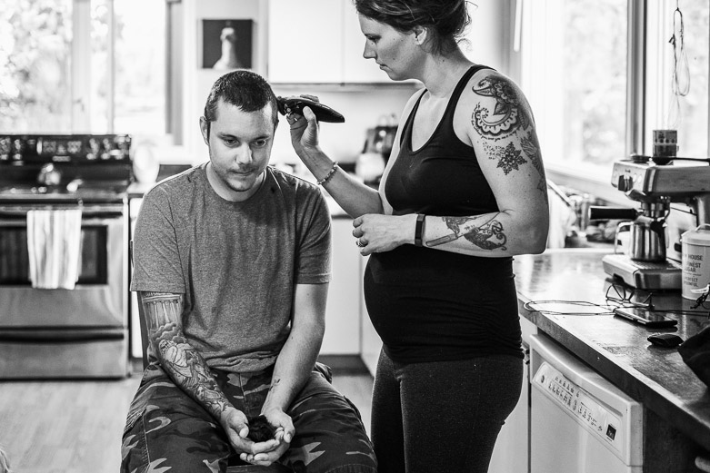 Wife gives husband a haircut at home