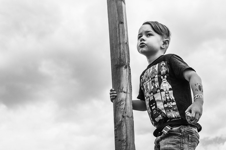 Young boy on a wooden fence