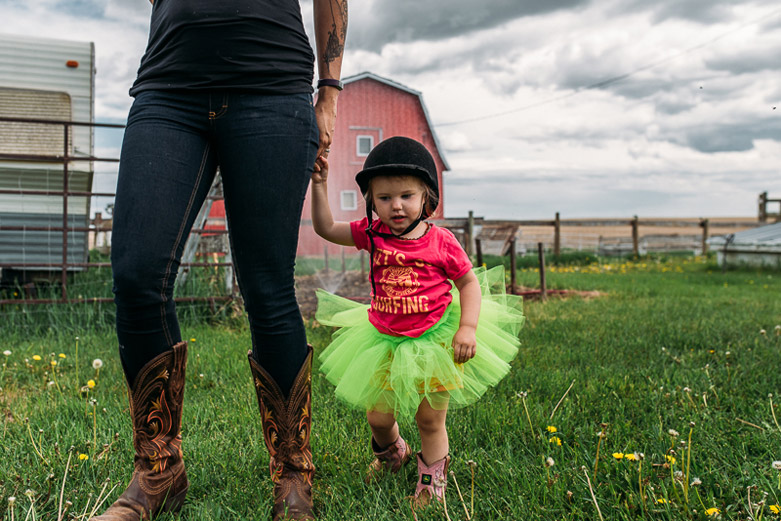 Mother and daughter holding hands on Alberta farm
