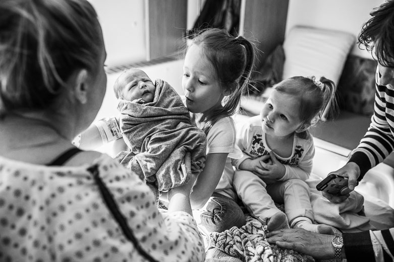 Mother, daughters and newborn boy