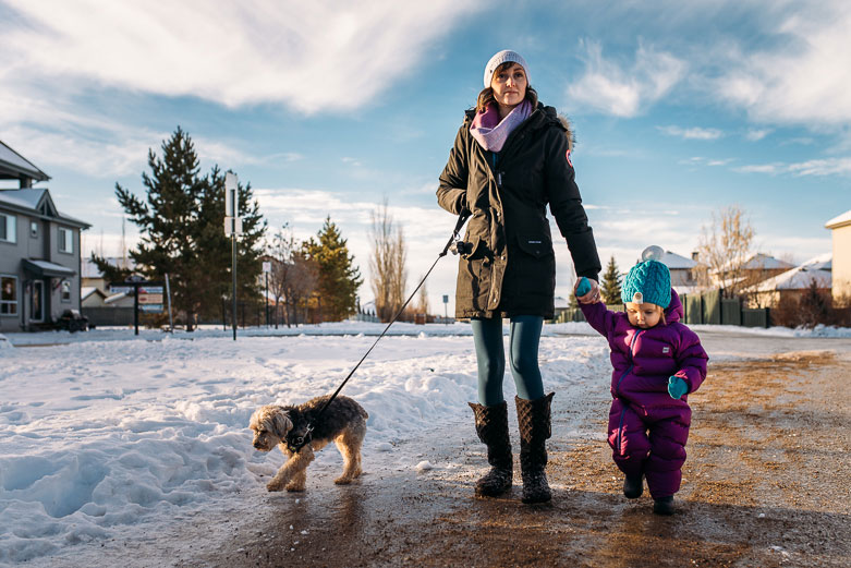 Mother, daughter and dog on winter walk