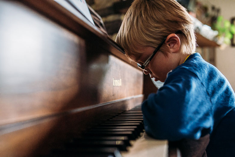 Boy discouraged he has to play the piano