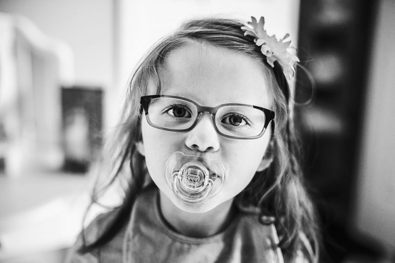 Girl with soother in her mouth