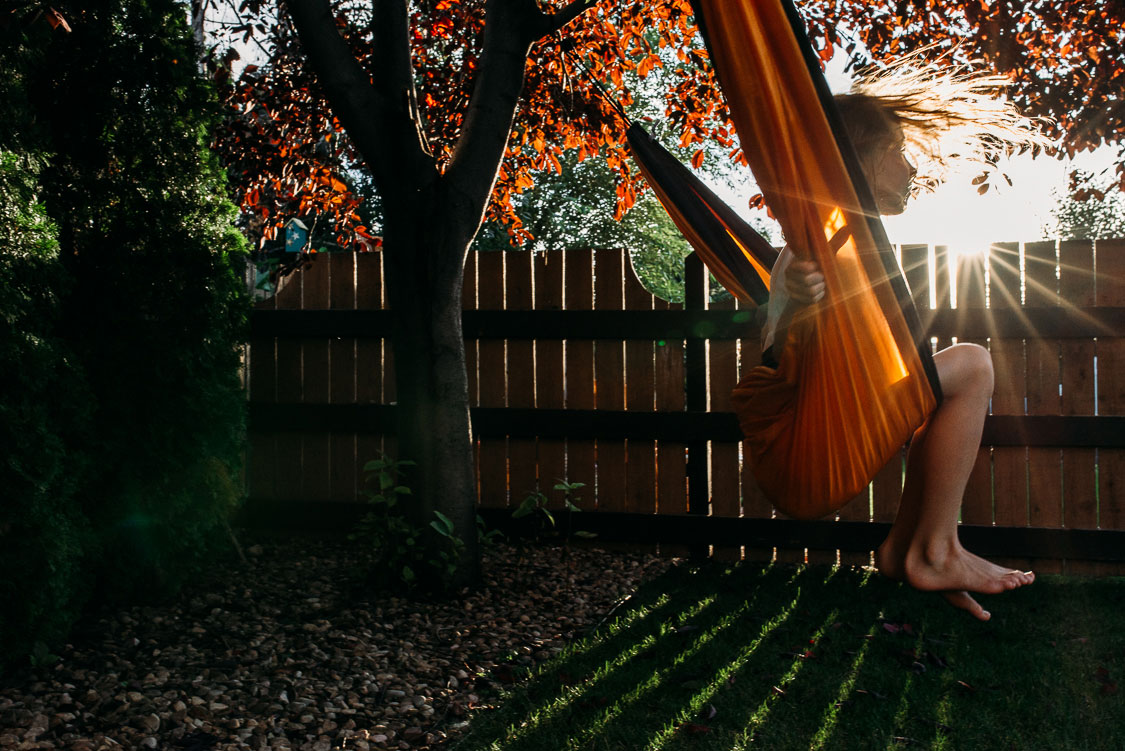 Girl swinging on a hammock
