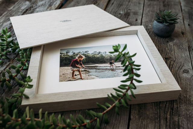 Collection of matted fine art prints in a story box