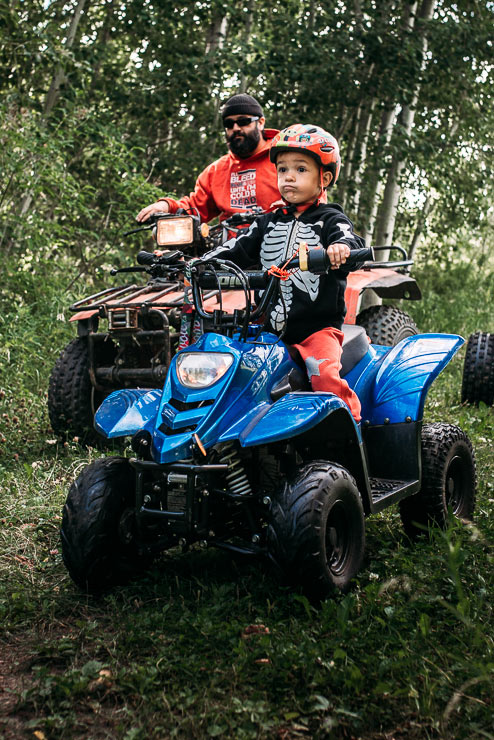 Young boy and his father on their quads