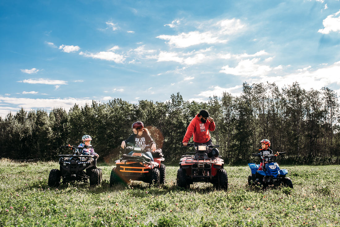 Family of four on their quads