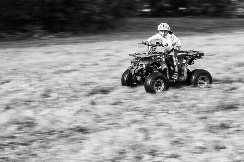 Girl going fast on her quad