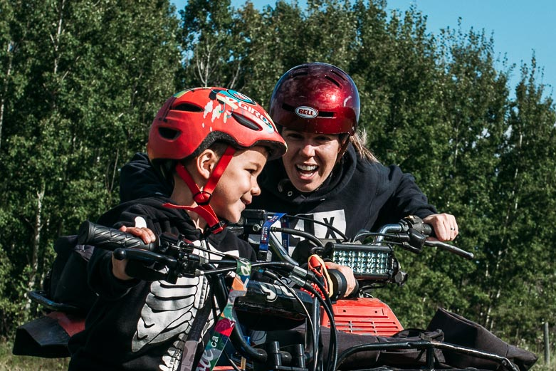 Mom and boy laughing during a quad ride