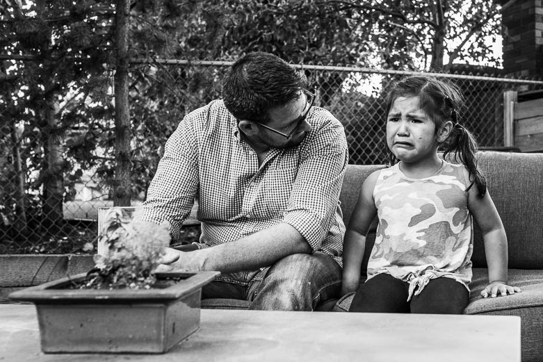 Sad girl sitting by father